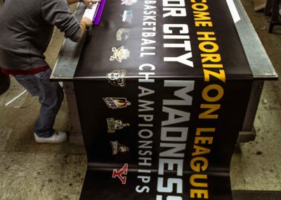 Large-Format Banner being trimmed for production