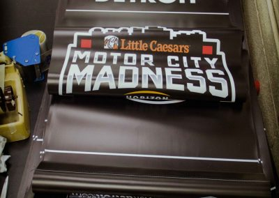A stack of Welcome Banners for Motor City Madness 2017