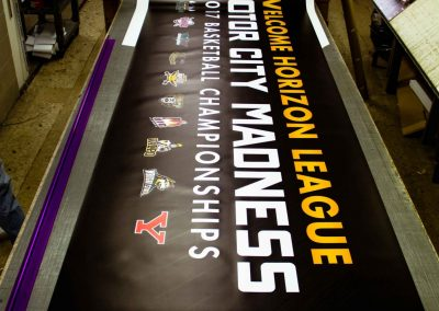 This BIG Banner being cut to welcome visitorss to the 2017 Motor City Madness Horizon League