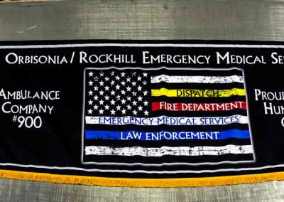 Parade Banner with consistent design to the EMS flags eventually carried in the Huntington Parade